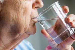 Elderly Woman Drinking Water